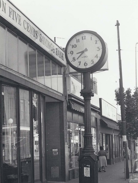 Clock outside the Boston Five Cents Savings Bank at 696 Centre St.
