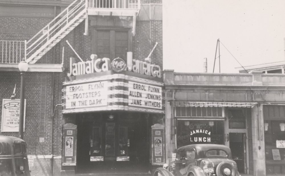 A clock stood in the lobby of the Jamaica Theatre in Hyde Square.