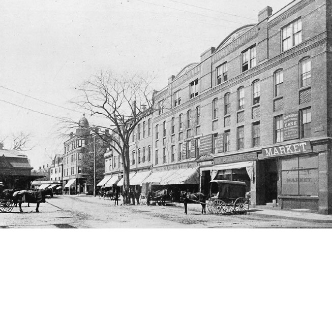 The Woolsey Block in 1895 was a four-story commercial block with Nelson's Grocery Store, the Jamaica Plain News Depot, and the West Roxbury Co-operative Bank. Courtesy of William Dillon.