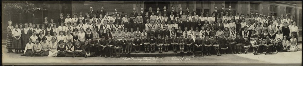 The West Roxbury High School class of 1921.  West Roxbury High School was located at 76 Elm St. in present day Jamaica Plain. You may also  download  a high-resolution version of this photograph.  The Jamaica Plain Historical Society would like to extend our thanks to Edward Barrett for donating this photograph.