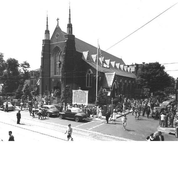 Parishioners leave Saint Thomas Aquinas Church after Sunday mass during World War II. The church was built in 1873 at the corner of South and Saint Joseph Streets and was designed by architect Patrick J. Keeley.