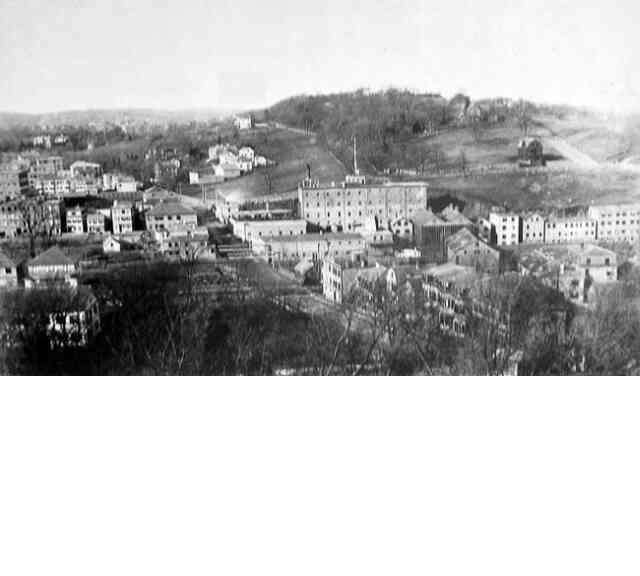 In this view of breweries and factories along the Stony Brook Valley, a portion of Mission Hill can be seen in the background. Courtesy of the Jamaica Plain Branch of the Boston Public Library.