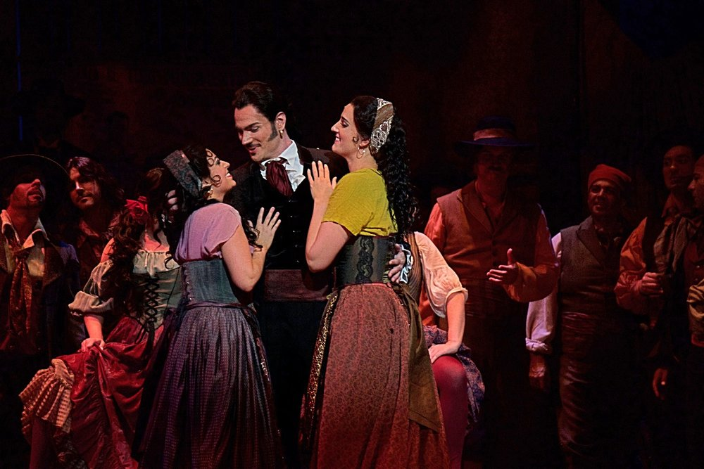 Elena Galván (Frasquita), Ryan Kuster (Escamillo), Courtney Miller (Mercedes) in  Carmen  at Florida Grand Opera  Photo credit: Lorne Grandison