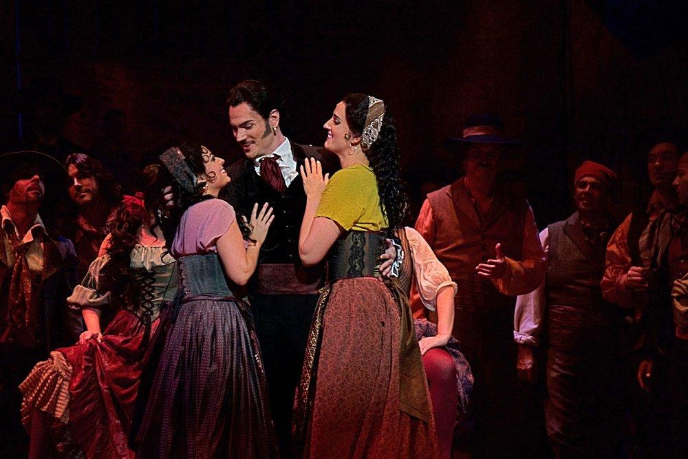 Elena Galván (Frasquita), Ryan Kuster (Escamillo), Courtney Miller (Mercedes) in  Carmen at Florida Grand Opera  Photo credit: Lorne Grandison