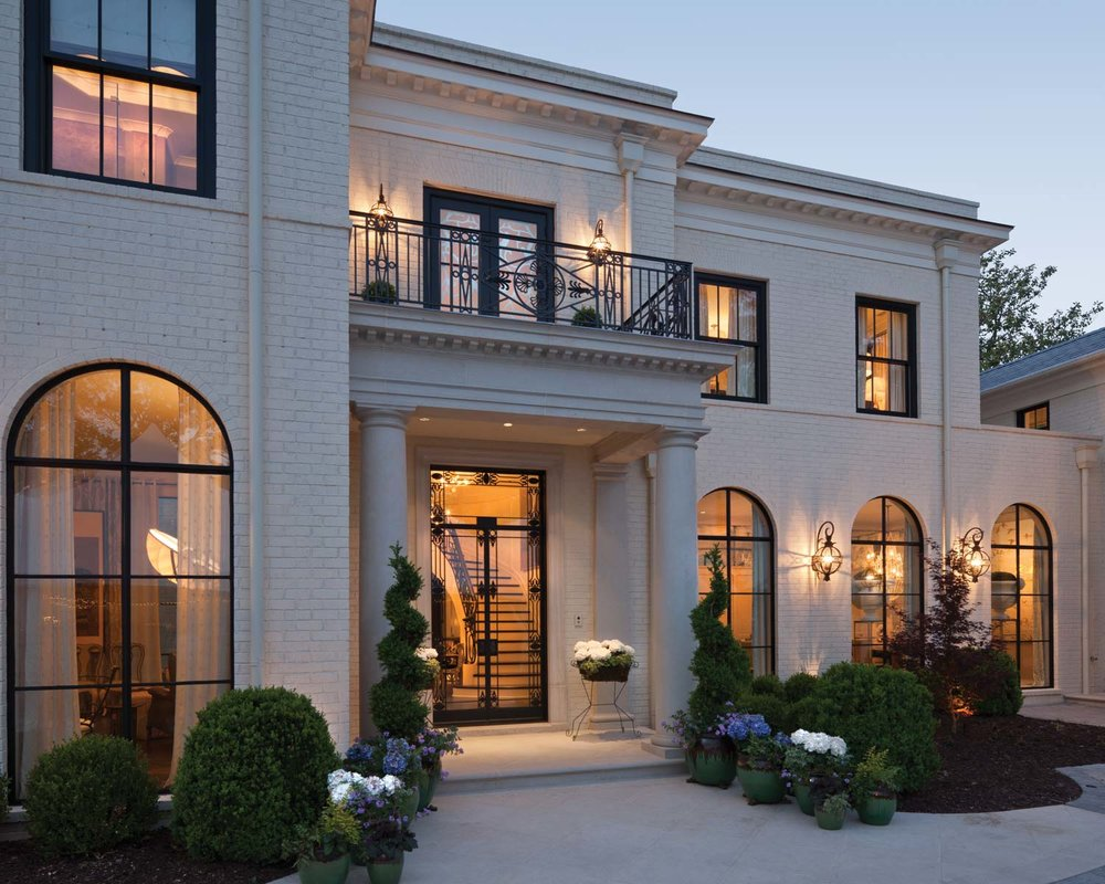 Lotus House - This Regency-style residence in Atlanta stylistically connects to the Raj in India. A sophisticated architectural design with white painted bricks and limestone accents, Lotus House would be just as at home in India or Georgia.EXPLORE
