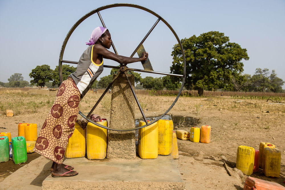 manual water pumping. Burkina Faso
