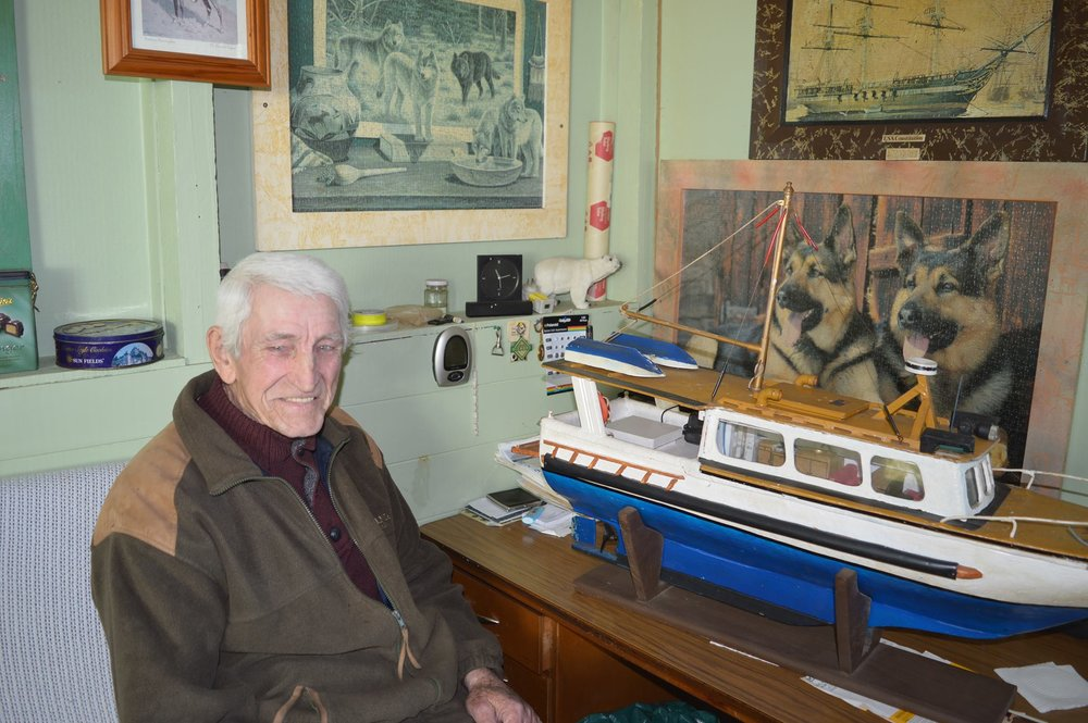 Mike Leszkoven of Winnaleah with the first model boat he made 50 years ago.