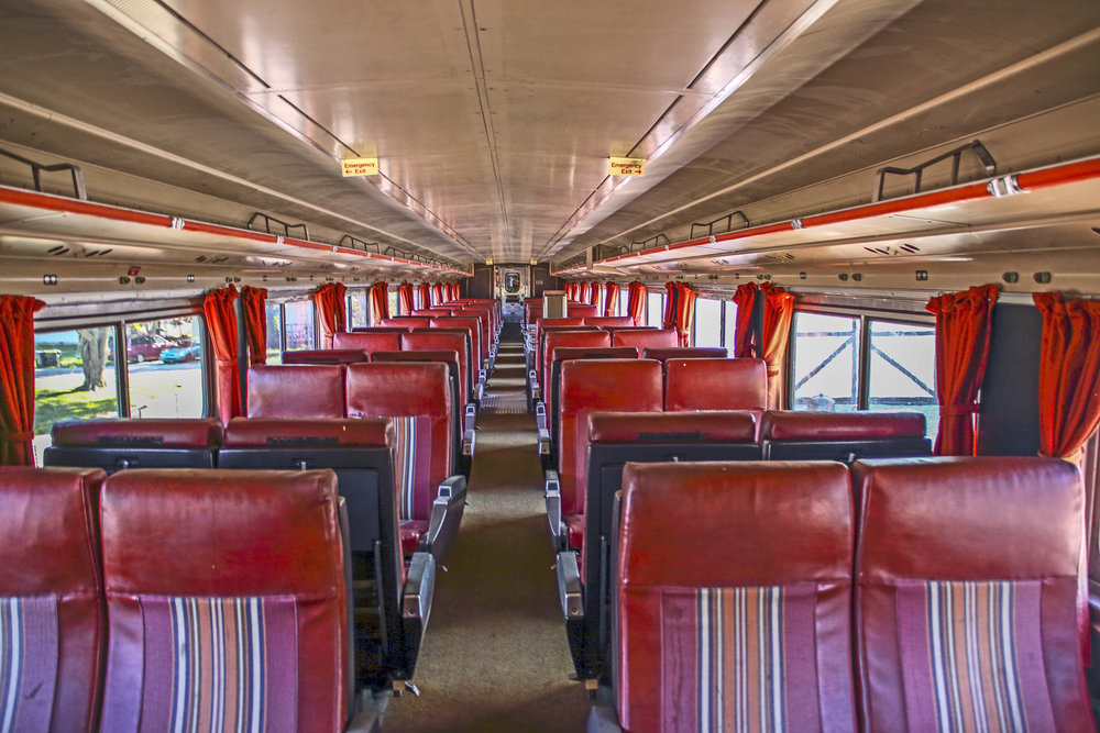 Upper level passenger car seating