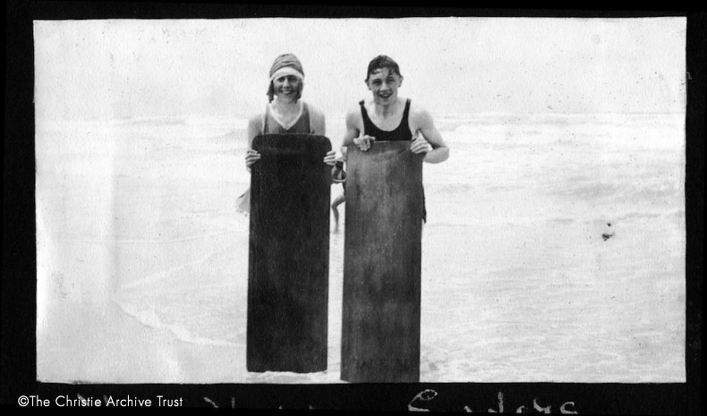 Agatha Christie and a young naval attaché named Ashby stand on Muizenberg Beach, South Africa. Photograph from Agatha Christie Archive_2.jpg