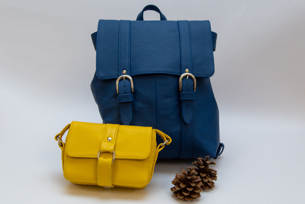Freeload Accessories - Royal Blue Medium Leather Backpack - £210.00Yellow Leather Mini Berry Handbag - £120.00 Buy at Freeload's Cockington Court studio and www.freeloadaccessories.com