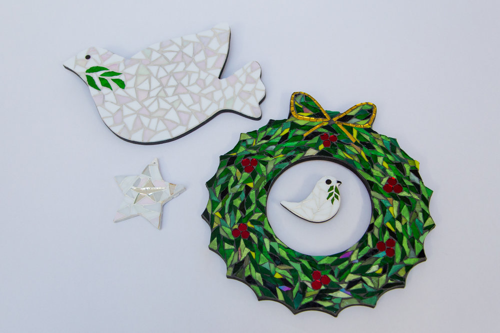 Janet Ventre Mosaic - Mosaic Christmas decorations:Dove - £40 Wreath - £50Christmas tree decorations - £15 eachBuy at Janet's Cockington Court studio