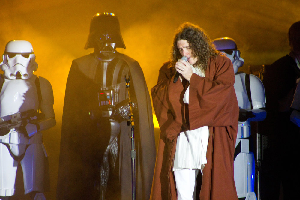 Mark (as Vader) and the 501st rocking out on stage with Weird Al Yankovic.
