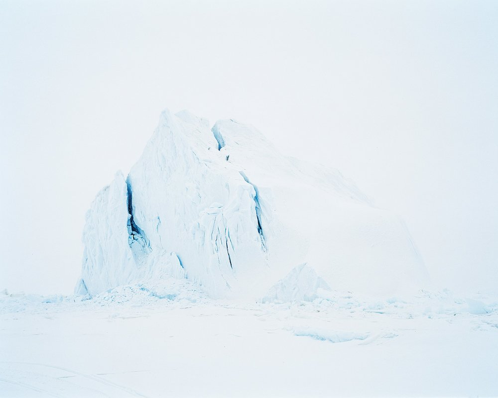 "Philip Jessup - Iceberg, 2017, 16""x20""Philip Jessup's body of work reflects decades of professional activity advocating low carbon economies in world cities, including Toronto where he served as executive director of the City's climate agency for nine years. Realizing that photography can deepen public awareness of climate threats to the planet, since 2007 he is has documented the beauty and fragility of significant landscapes — currently coastal marshlands and low lying islands — that we can save from climate change if we take the right steps.Phil has exhibited his work in Toronto, Montréal, London, U.K., Washington DC, Louisville, and New Orleans. The Victoria and Albert Museum (V&A) in London recently selected a large cibachrome print, Flooded Tree (2005), for its seminal retrospective, Into the Woods: Trees in Photography. The V&A and several international corporations collect his work. He won a Bronze Medal for an image, Snake Grass, at the Royal Photographic Society's 148th international competition in 2005.Sea level rise is accelerating, according to a recent U.S. National Academy of Sciences report. Seas could rise three-to-five feet by 2100, inundating many of these low-lying coastal marshland areas. Climate change is also stressing inland marshes like Minesing, causing substantial die off of valuable woodlands.Jessup shoots in medium format using a Phase One XF camera. He is enjoys a saturated Kodachrome color palette and strives visually to balance the real with the abstract."