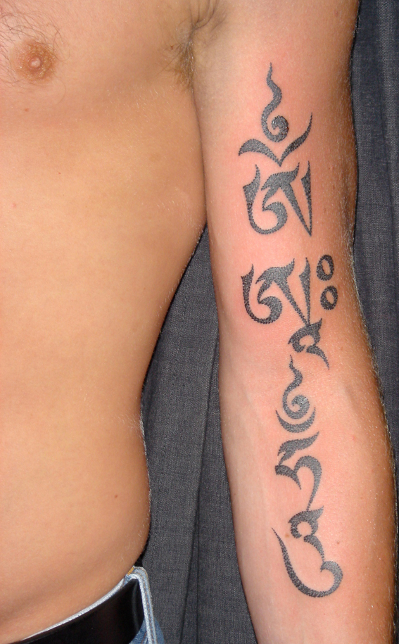 Script and design by Tashi - The three gates, body, speech and mind, Om Aa Hum, in a stylised Uchen script i designed, dot effect tattoo by Xed le Head.