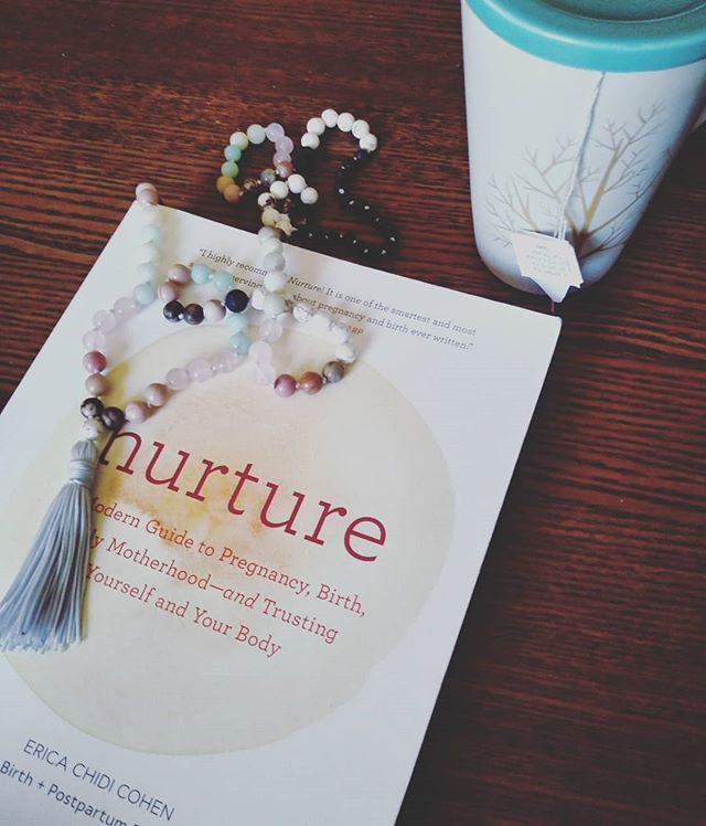 "A few third trimester comforts: @thenurturebook by @ericachidicohen , my homemade ""motherhood mala"", and a cuppa @tradmedicinals red raspberry leaf tea. 💓 . . . . . . #pregnancy #3rdtrimester #expecting #Toronto #MomsTO #Torontodoula #postpartumdoula #thenurturebook #redraspberryleaftea #mala #motherhood #ig_motherhood #ig_baby #comforts #mindfulness #30weekspregnant"