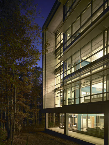 CORPORATE HEADQUARTERS DUSK THRU TREES - OOMBRA ARCHITECTS