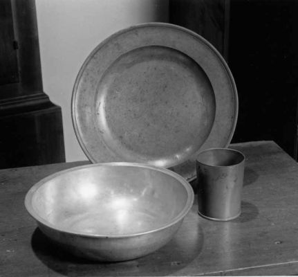 Late 18th century Deep Run East baptism bowl and communion bread plate, and 1746 communion cup. Credt: Jay Ruth
