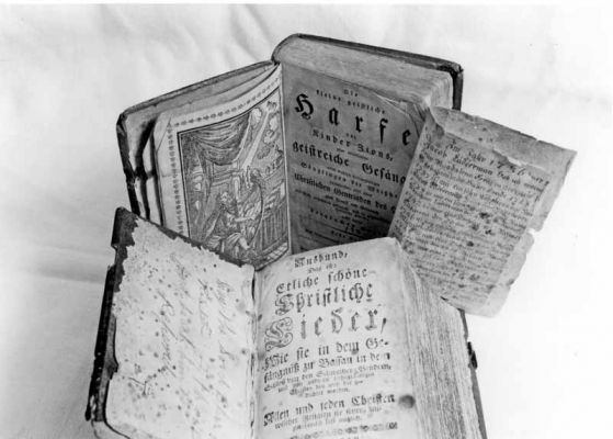 Two early hymnbooks used at Deep Run were the Aubund (bottom) and the Zion's Harpe (top) The Ausbund was used in the 1700s. The Zion's Harpe was introduced in the early 1800s. This particular Ausbund hymnal also contained Leatherman family records (right). Credit: Jay Ruth