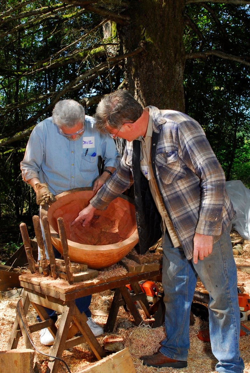 Woodturners Dale Larsen and David Williams inspecting a large bowl.