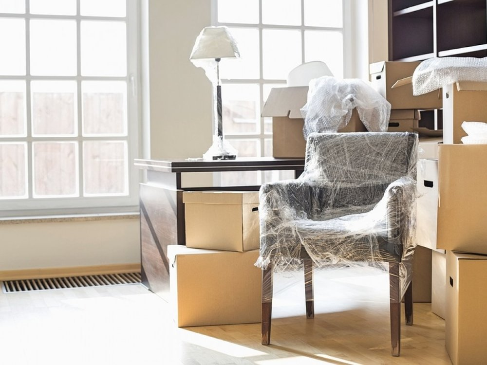 Moving-boxes-and-furniture-in-169360670.jpg