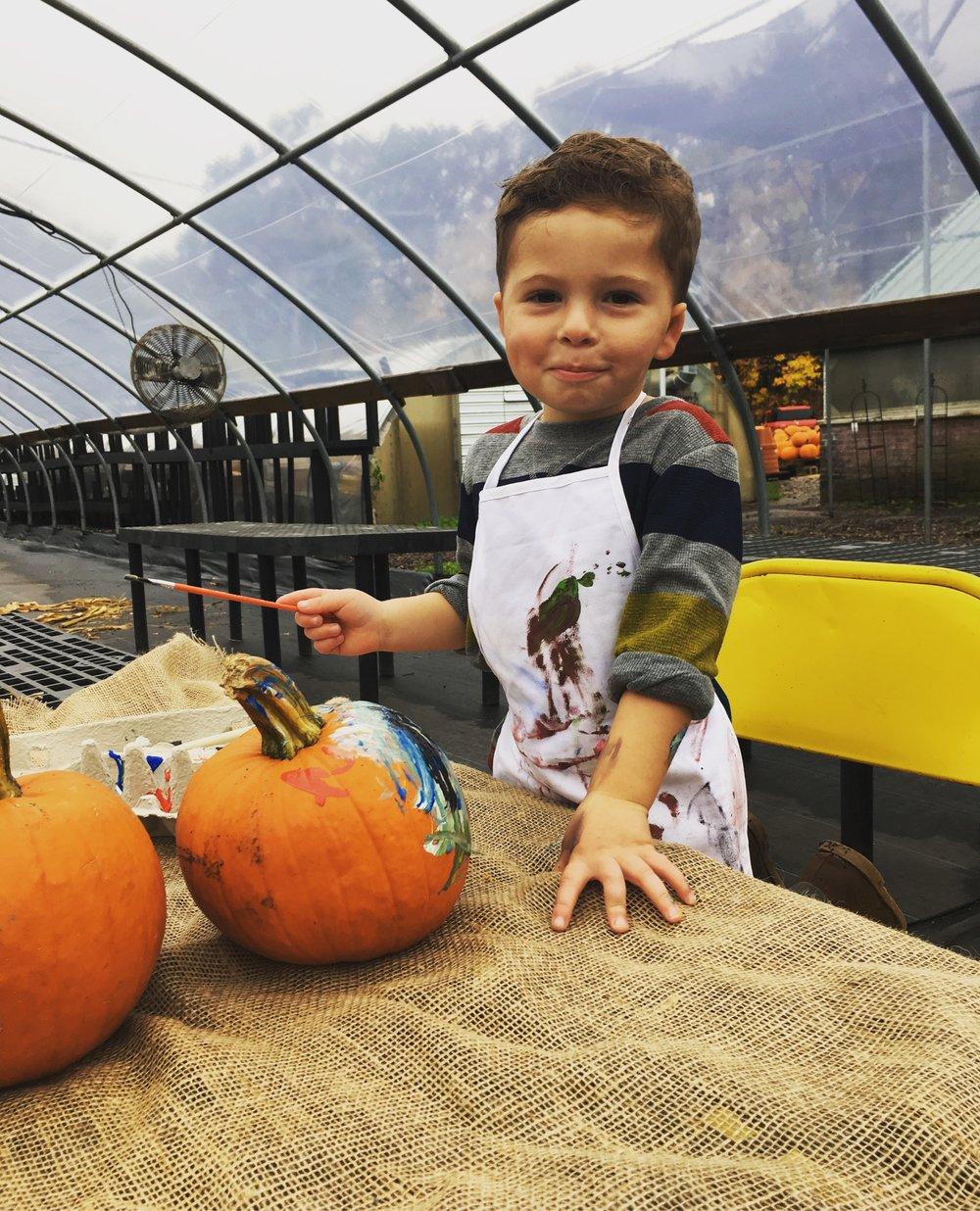Wes paint a pumpkin.JPG