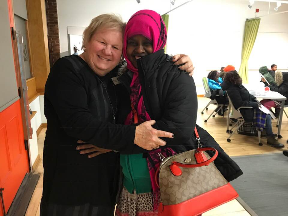 SCBWI Executive Director and Founder, Lin Oliver, and friend at the SCBWI BOOKS FOR READERS Refugee Dream Center Celebration, Providence, RI.