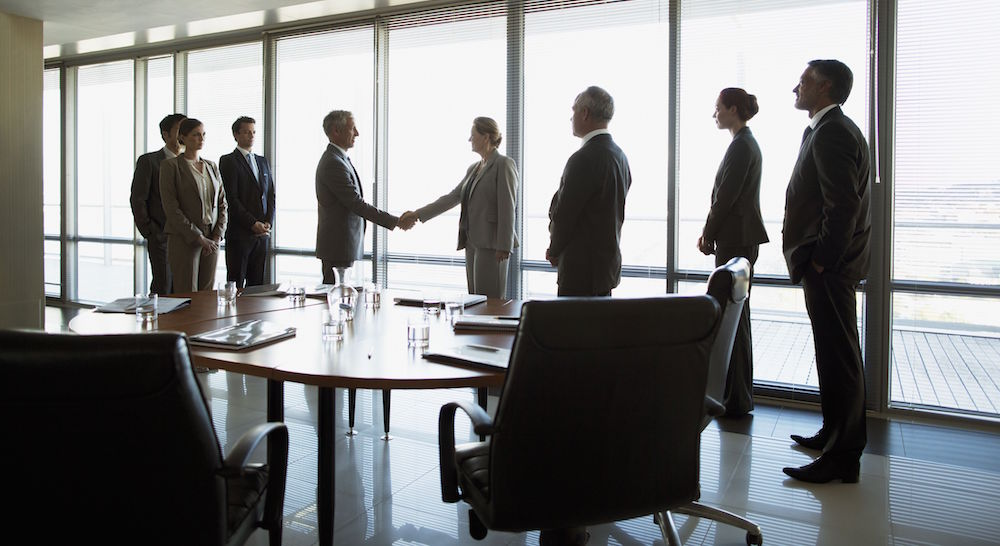 business-people-shaking-hands-in-conference-room-147205360-582f5cdf3df78c6f6a0aef4e.jpg