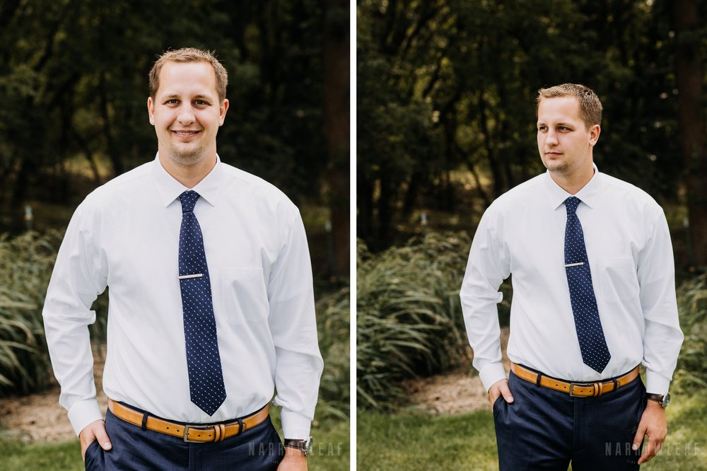 comfortable-groom-navy-blue-pants-tie-white-button-up-shirt-brown-leather-belt.jpg