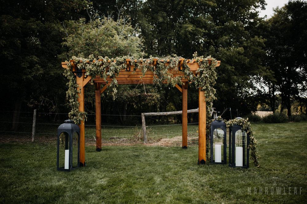 backyard-summer-farm-wedding-greenery-arch-large-lanterns-32.jpg