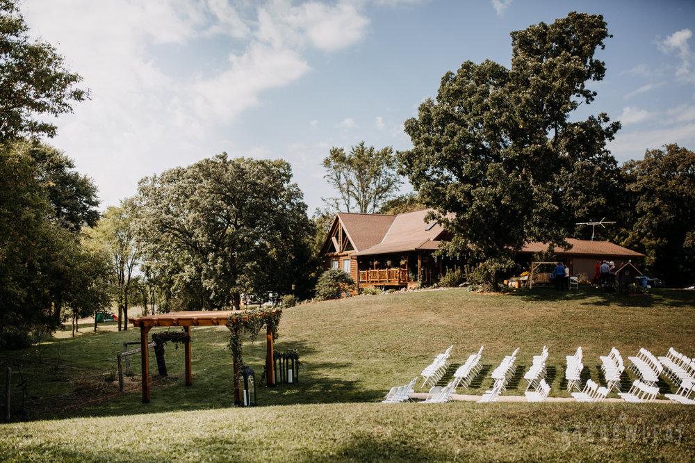 backyard-summer-farm-wedding-greenery-arch-large-lanterns-34.jpg