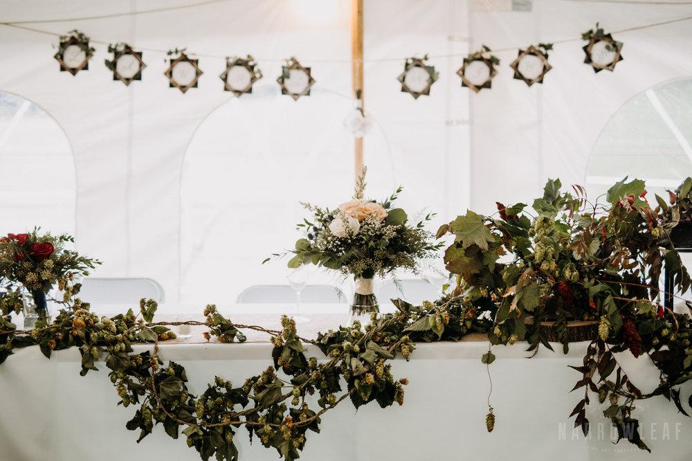 greenery-vine-head-table-decor-tent-wedding-reception-32.jpg