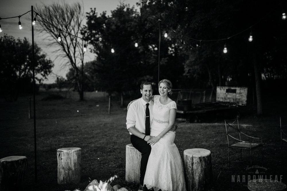 bride-groom-cuddling-by-the-bonfire-under-cafe-lights-night-32.jpg