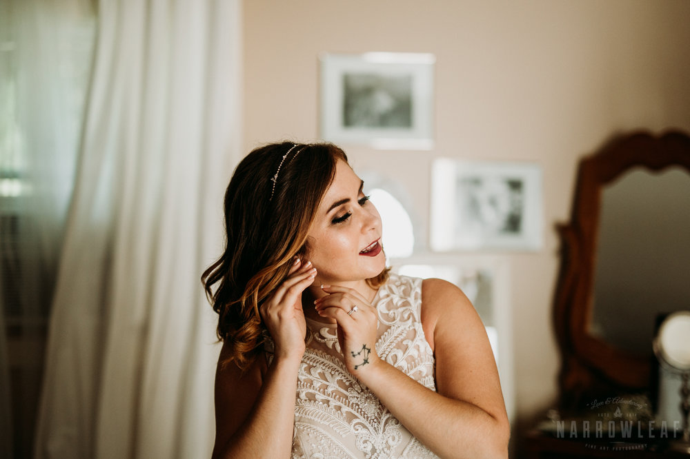 bride-getting-in-dress-details-at-burlap-and-bells-wi-48.jpg