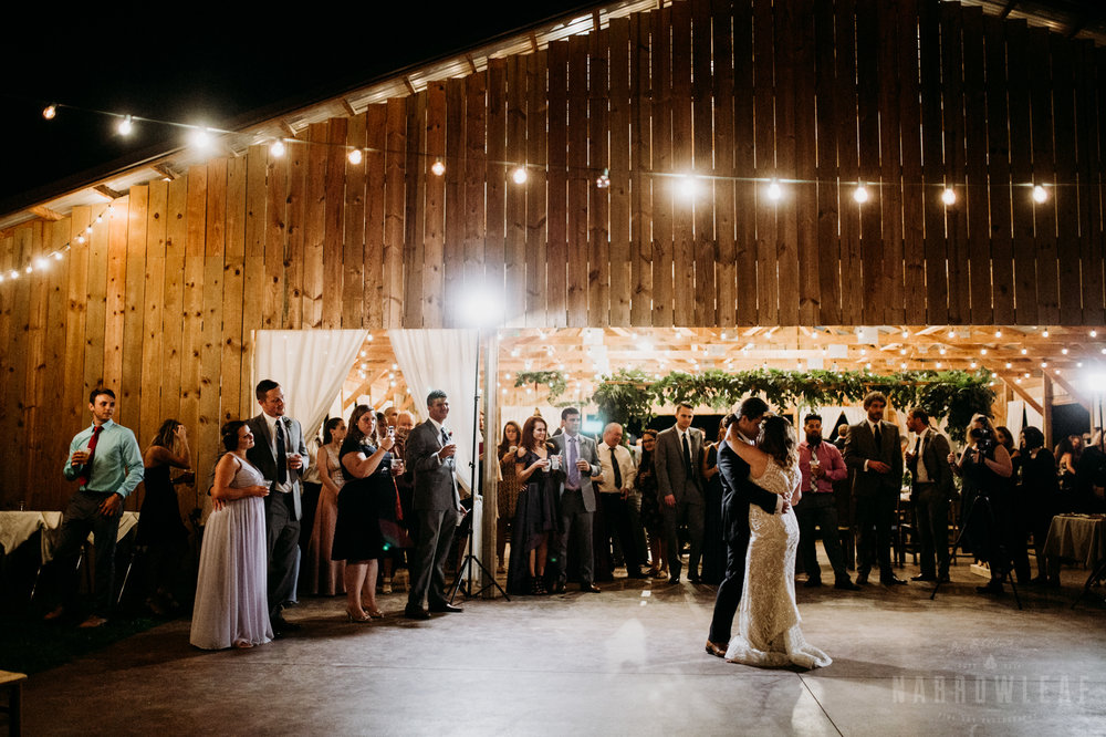 romantic-bride-groom-first-dance-outdoors-under-cafe-lights-at-night-wi-5.jpg