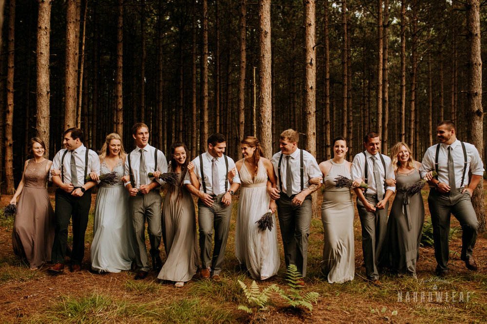 wild-bridal-party-photos-in-the-woods-suspenders-pastel-dresses-Narrowleaf_Love_and_Adventure_Photography.jpg