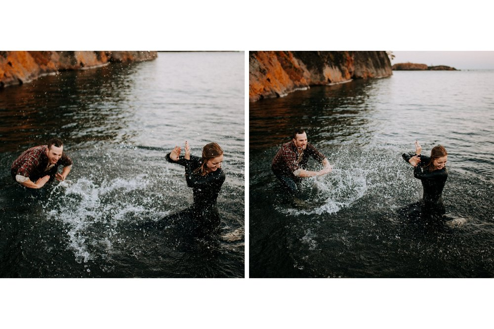 Adventurous engagement photography of couple in lake Superior