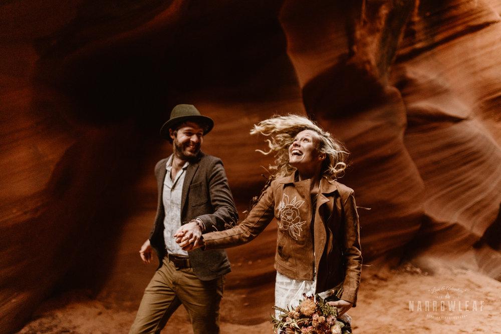 elopement-couple-running-through-canyon.jpg