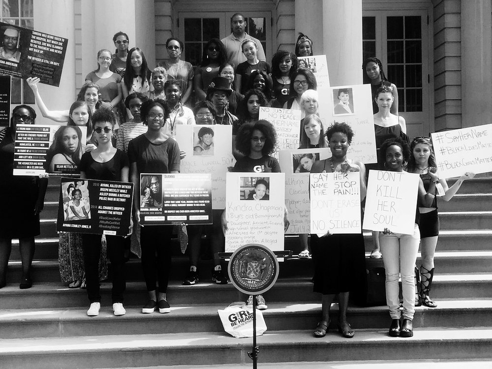 #SayHerName (2016)  New York, NY, July 13, 2016: In solidarity with and continuation of the AAPF #SayHerName campaign, members of Girl Be Heard's performance collective debuted new work on the steps of City Hall on Wednesday, July 13, 2016 at 10am, to commemorate Sandra Bland and the four other black women who lost their lives in police custody in July 2015. Girl Be Heard youth used spoken word, music, and live storytelling to honor and shine light on these women's lives, bridging art and activism in an effort to make visible these civic injustices and open up community dialogue.
