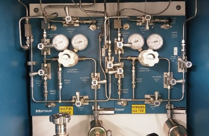 Toxic Gas Manifold - Gas manifold connected to gas cabinets in the Specialty Gas Lab. All cabinets and the entire laboratory is connected to a centralized gas monitoring alert system.