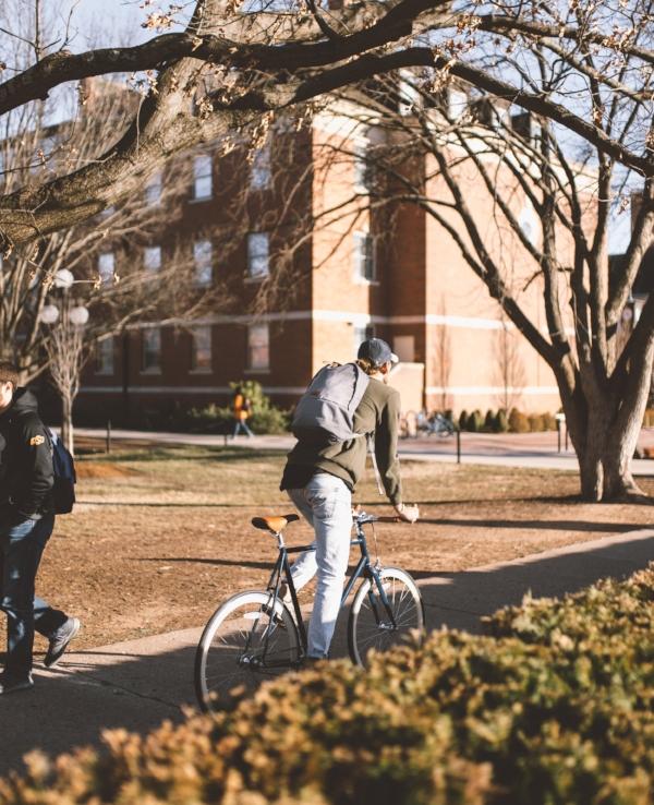 College kid on bike.jpg