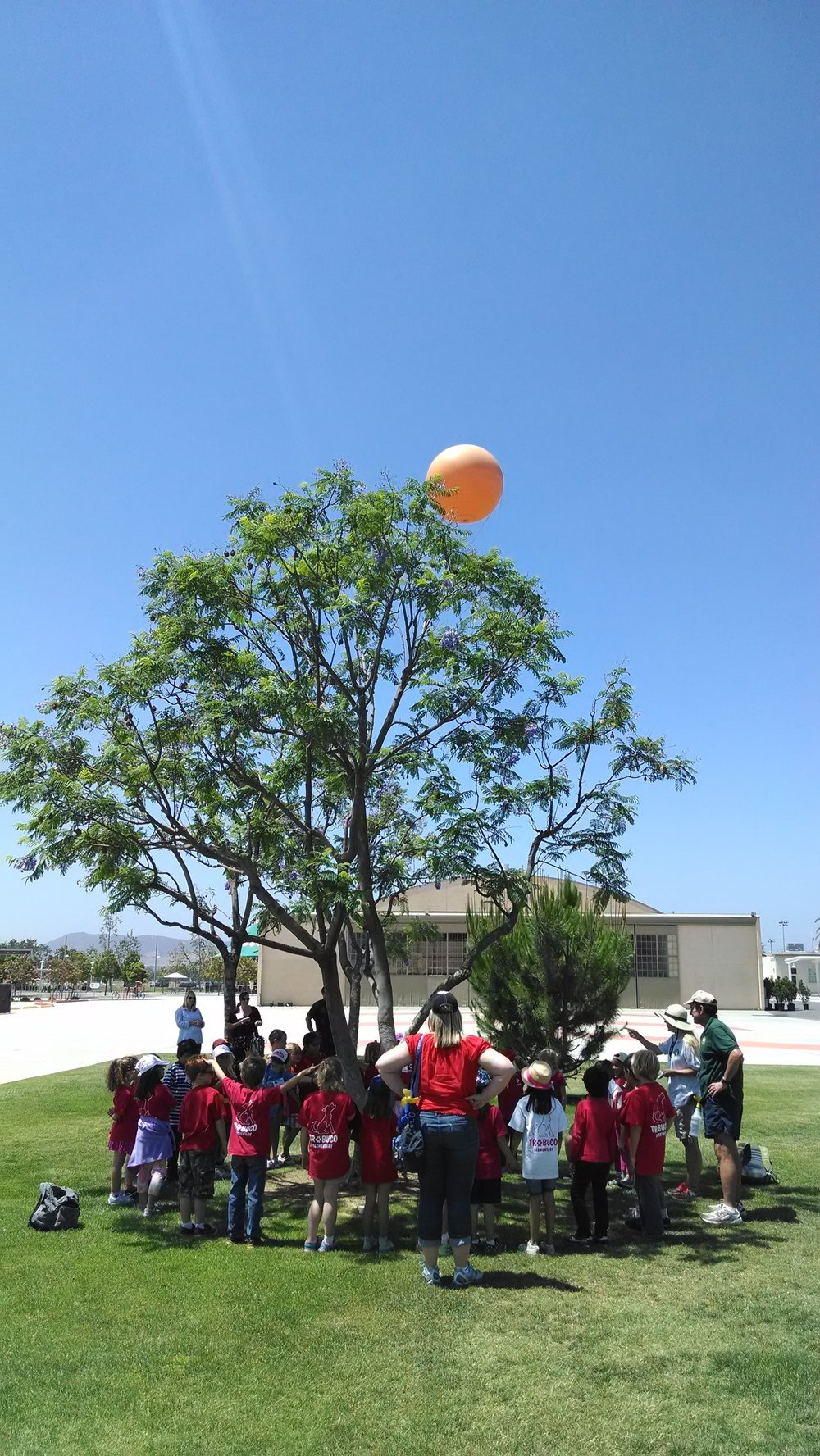 OCGP Students group shot looking at balloon.jpg