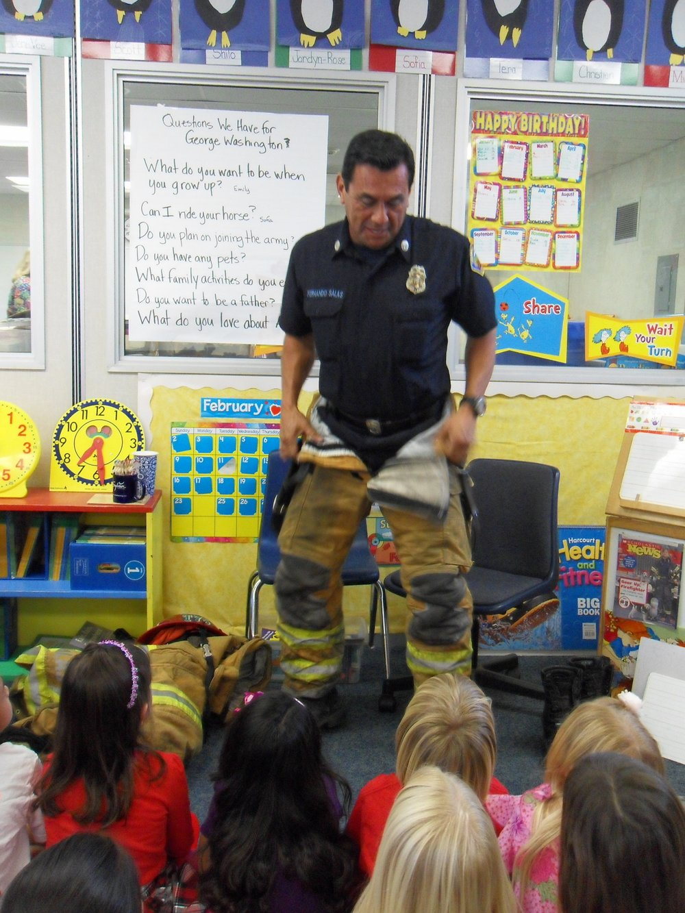 Firefighter Fernando suiting up.jpg