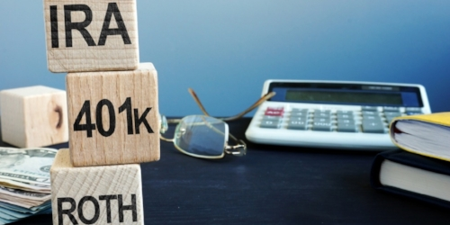 cubes-with-words-ira-401k-and-roth-retirement-plan-picture-id1075439318.jpg