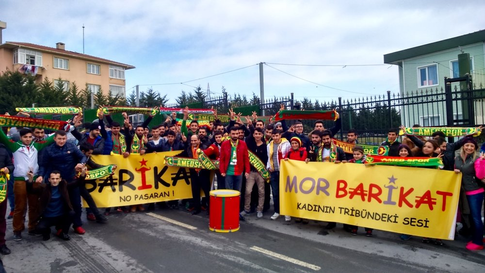 Amedspor fans ahead of a Turkish Cup match against Istanbul Basaksehir in 2016. The fan group name 'Barikat' means 'Barricade'. 'Mor Barikat' - 'Purple Barricade' - is a female Amedspor fan group.
