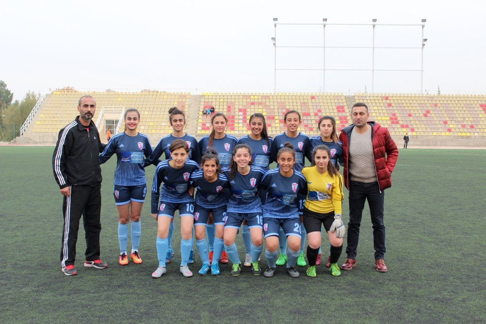 Dogan Deniz Celebi (far right) and Ikranur Sarigul (standing, fourth from right) with the Malatya Women's Sports Club (Photo by Patrick Keddie).jpg
