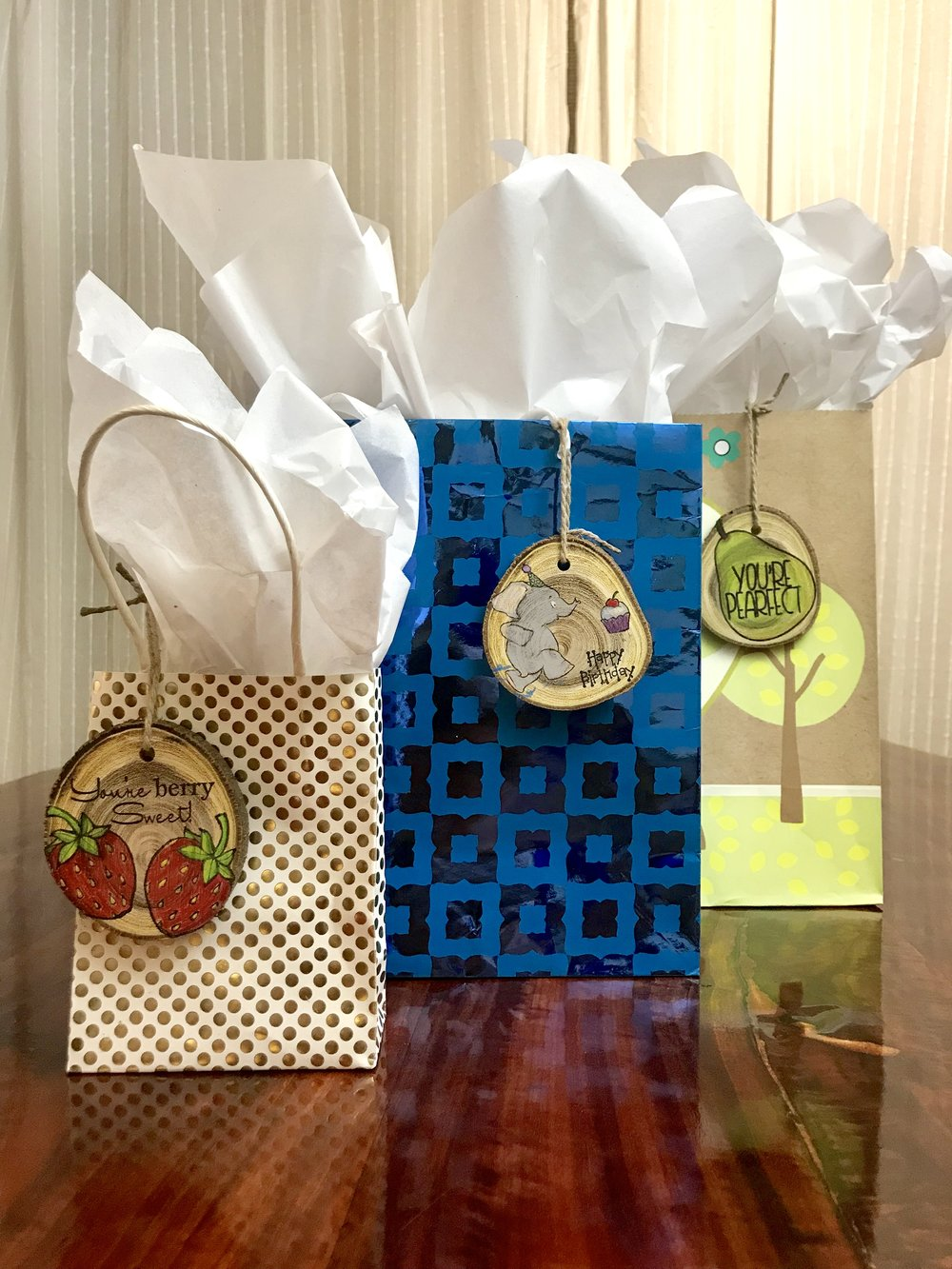 "Spice up your gift giving with custom wood tags. These tags add pizazz whether they're added to a gift box, gift bag, flowers, etc. All tags have a ""To:"" and ""From:"" declaration on the back so grab a Sharpie and have at it.  Tags are considered ""thin wood slices"". Thickness may vary. Sizes can range from 2.5"" - 4"" and come with a twine string to hang your tag. - tag! you're it!"