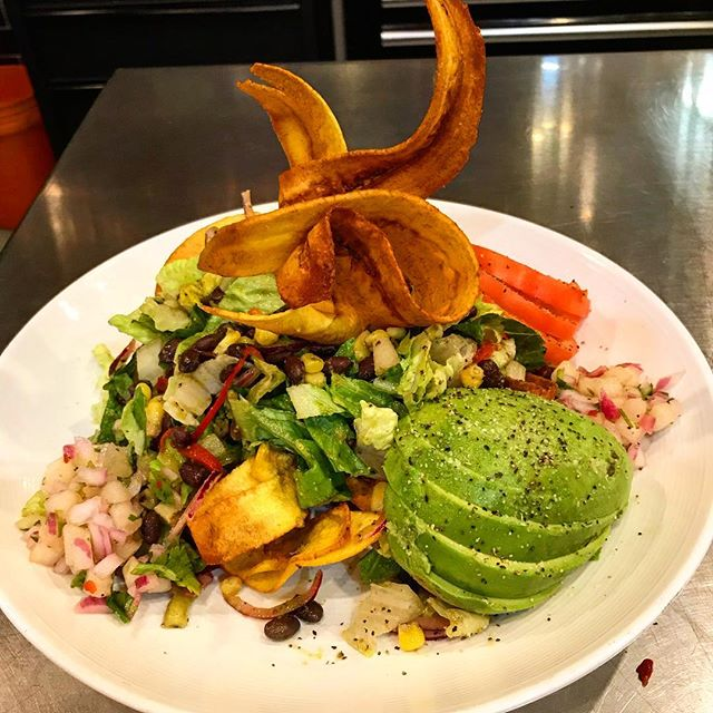 If you haven't tried our Tostone Salad yet, today's a good day for it... crispy plantains, seasonal fruit pico de gallo, avocado, black beans & corn, salsa verde #sorefreshing #alltheflavors #allthetextures #goesgoodwithamargarita #justsayin