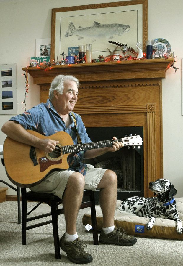 Musician Alex Bevan, pictured with his dog, Tilly, at his Madison home in August 2012