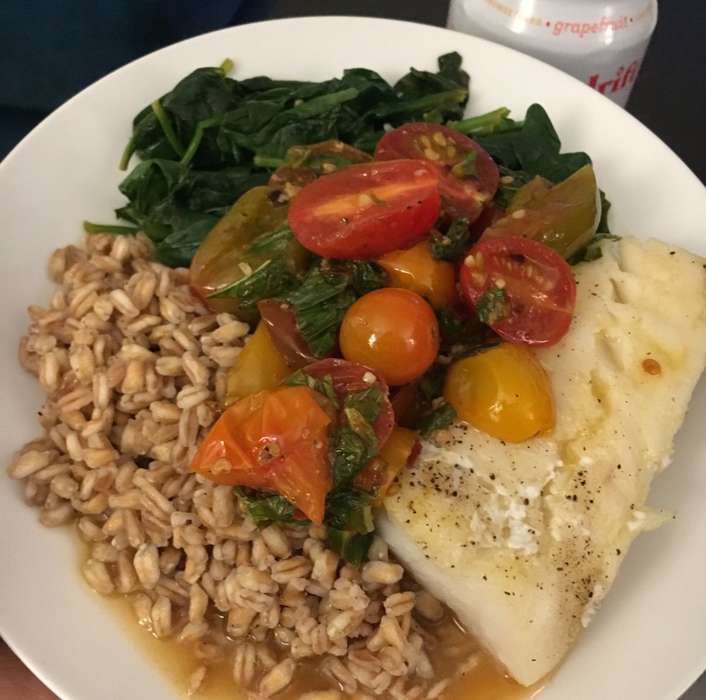 Pacific cod with farro, spinach, and tomato white wine sauce