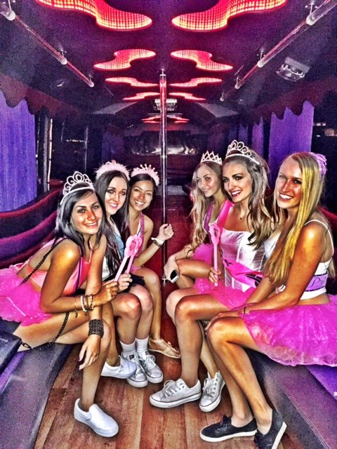 ladies-in-pink-celebrating-a-bachelorette-party-bus-in-downtown-san-diego